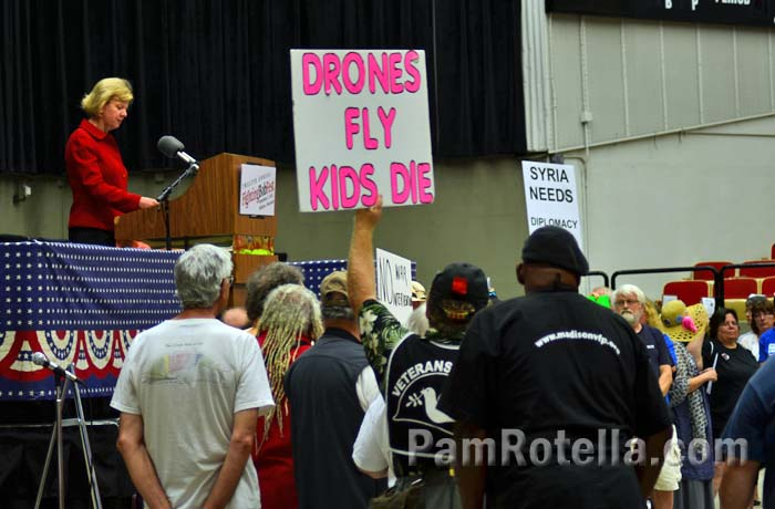 Anti-war activists protest Senator Tammy Baldwin at Fighting Bob Fest, 7 September 2013, photo by Pam Rotella
