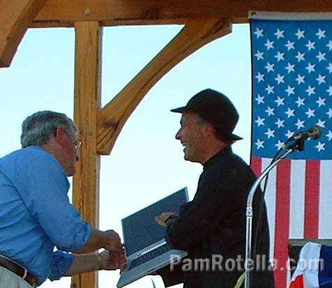 Author Greg Palast shows Wisconsin politician Ed Garvey some of Katherine Harris' software at Fighting Bob Fest