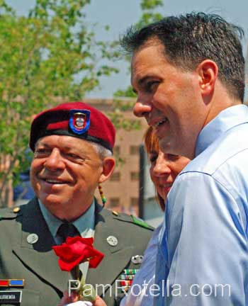 Walker campaigning at Memorial Day services 2012, photo by Pam Rotella