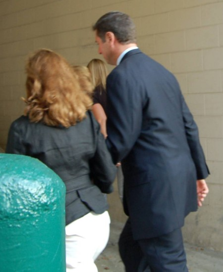 Allen flees reporters with his wife, photo by Pam Rotella
