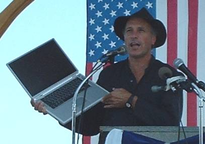Greg Palast shows Katherine Harris' vote-rigging software to crowds at Fighting Bob Fest 2003